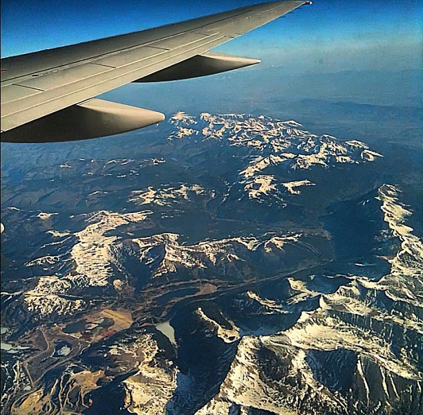 rocky mountains from an airplane window