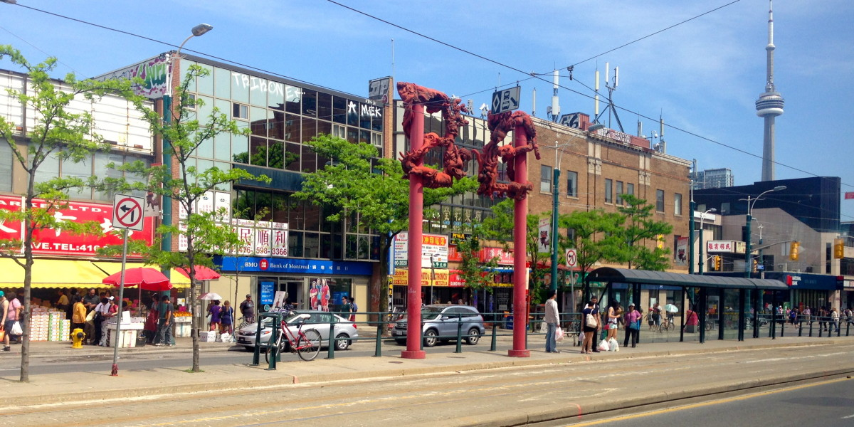 The gates of Toronto's Chinatown with the CN Tower in the background.